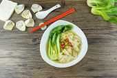 Homemade Chinese Shrimp Wonton With Bok Choy And Braised Pork In Soup On Wooden Table - Asian Food S poster