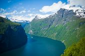 Magnificent Geiranger Fjord. Norway. It Is A Fairytale Landscape With Its Majestic, Snow-covered Mou poster