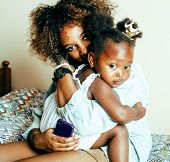 Adorable Sweet Young Afro-american Mother With Cute Little Girl, Lifestyle People Concept poster