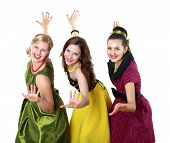 image of poodle skirt  - three stylish young woman in bright colour dresses - JPG