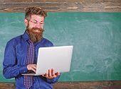 Surfing Internet. Teacher Bearded Man With Modern Laptop Surfing Internet Chalkboard Background. Hip poster