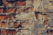 Red Brick Wall In The Cracks. Shattered Brick Wall Close Up. Old Ruined Brick Wall. Dilapidated Bric poster