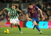 BARCELONA - JAN, 15: Jose Cañas(L) of Real Betis vies with Cesc Fabregas(R) of FC Barcelona during