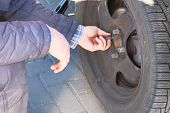 Male Hand Is Changing Tyre At Car, Close Up. Wheel Balancing Or Repair And Change Car Tire. Auto Rep poster