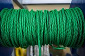The Green Rope Is Reeled Up On The Coil In Shop. A Saving Or Safety Rope For Climbers. Texture Of A  poster