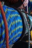 Blue Rope On A Show-window Of Shop. A Safety Rope For Climbers. The Rope Is Reeled Up On The Coil. T poster
