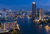 View over the city of bangkok at night with chao phraya river