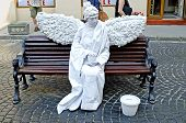 Living Statue - A Woman In The Image Of A White Angel