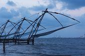 Kochi Chinese fishnets in twilight. Fort ?ochin, Kochi, Kerala, India