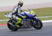 Italian Valentino Rossi Of Fiat Yamaha Team Looks Back At Other Racers At 2008 Polini Malaysian Moto