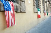 American Italian Flags Hanging From Building Windows