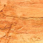 Red Rock Background Texture Pattern From Ocres Du Roussillon, France.