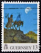 GUERNSEY - CIRCA 1971: A stamp printed in Guernsey shows the arrival in Bethlehem of Mary and Joseph