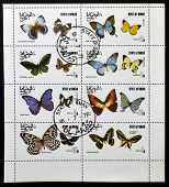 OMAN - CIRCA 1977: A collection stamps printed in Oman shows a series of eight pictures of butterfli