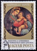 HUNGARY - CIRCA 1983: stamp printed in Hungary shows la Vierge a la chaise by Raphael on the 500th a