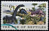UNITED STATES OF AMERICA - CIRCA 1969: A Stamp printed in USA shows the Brontosaurus Stegosaurus & A