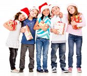 Happy children with Christmas gifts - isolated over a white background