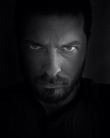 stock photo of scary face  - Low key portrait of scary looking man - JPG