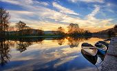 Boats on the river at sunset in Belves