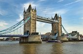 stock photo of old bridge  - pleasure boat passing under Tower Bridge - JPG