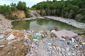 CHONBURI, THAILAND - JULY 14 : A mountain of dirty trash surrounding the lake in Chonburi Province o