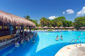 PLAYA DEL CARMEN, MEXICO - JULY 14: Scenery of luxury swimming pool at RIU Tequila Hotel  in Playa d