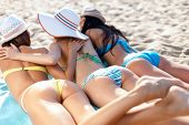 stock photo of sunbathers  - summer holidays and vacation  - JPG
