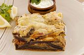 picture of aubergines  - Delicious Greek moussaka with aubergine and a side garden salad - JPG