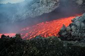stock photo of magma  - Etna vulcan lava magma in Sicily during an eruption - JPG