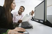 stock photo of half-dressed  - Man and woman using computer together - JPG