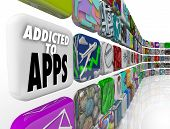 Addicted to Apps words on app tiles to illustrate our growing reliance on application and software o