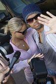 Closeup of celebrity couple and paparazzi