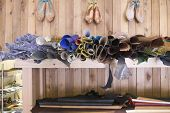 View of footwear materials in shelves at traditional shoemaker workshop