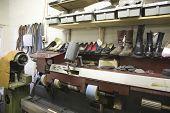 Footwear on shelves at traditional shoemaker workshop
