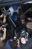 Elevated view of paparazzi around male celebrity