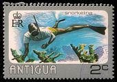 ANTIGUA - CIRCA 1976: A stamp printed in Antigua shows water snorkeling, circa 1976