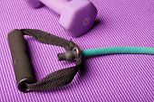Exercise equipment on a purple yoga mat