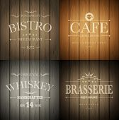 Bistro, cafe, brasserie and whiskey emblem templates on wooden background. Vector illustration.