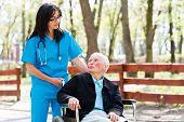 Senior Patient Talking With Kind Nurse