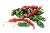 stock photo of pimiento  - Pimientos with hot peppers on a light background - JPG