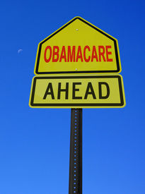 pic of lobbyist  - obamacare ahead conceptual directional post over blue sky - JPG