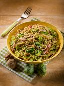 pasta with ham brussel sprout and nuts, selctive focus