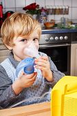 Adorable Toddler Boy Making Inhalation With Nebulizer