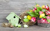 Easter Decoration With Eggs, Birdhouse And Tulips.