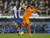 BARCELONA - JAN, 12: Pepe Lima of Real Madrid vies with Jhon Cordoba of RCD Espanyol during the Span