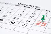 Horizontal Image Of A Calendar With Christmas Day Marked With A Green Tack