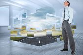 Happy businessman standing with hands in pockets against room with holographic cloud