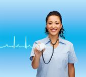 healthcare and medicine concept - smiling female african american doctor or nurse with stethoscope