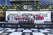 Daytona Beach, FL - Jan 24, 2014:  The field of champions pose for their group photo before the Rolex 24 at Daytona race at Daytona International Speedway in Daytona Beach, FL.