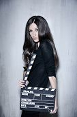 Beautiful Woman Holding Clapperboard